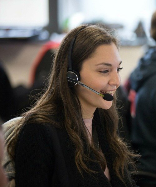 Games Workshop employee in trade sales smiling with headset on